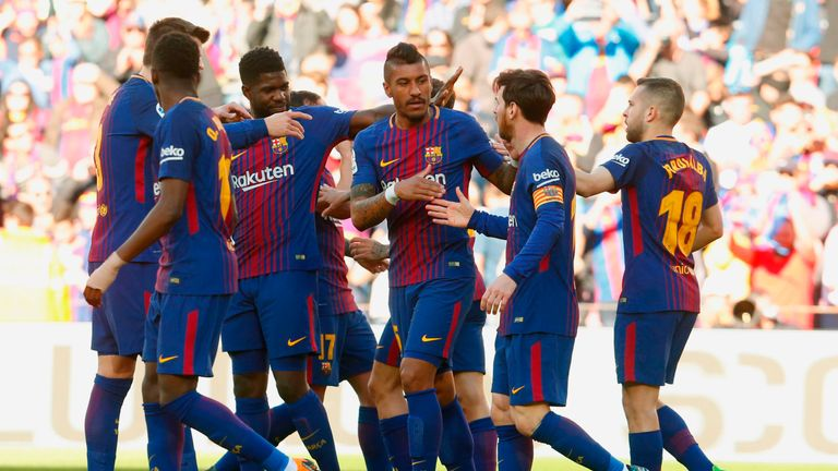 Barcelona players celebrate after Paco Alcacer scored during the Spanish League football match between FC Barcelona and Athletic Club Bilbao at the Camp Nou stadium in Barcelona on March 18, 2018