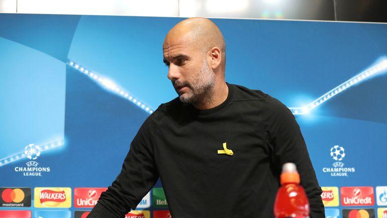 Pep Guardiola wears yellow ribbon at Manchester City press conference
