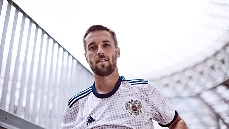 Dmitri Kombarov models the new Russia World Cup 2018 away shirt (credit   adidasUK) 6d7c8ea4c