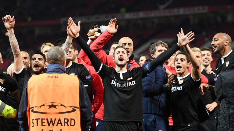 Sevilla celebrate their win over Manchester United at Old Trafford