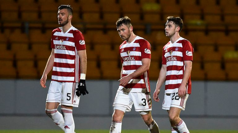 Hamilton's Xavier Thomas (left), Scott McMann and Darren Lyon leave the field dejected at full-time