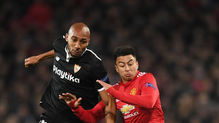 Steven N'Zonzi battles with Jesse Lingard during the Champions League tie
