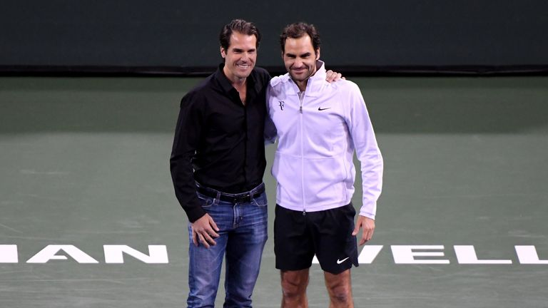Haas poses for pictures with his good friend and world No 1 Federer