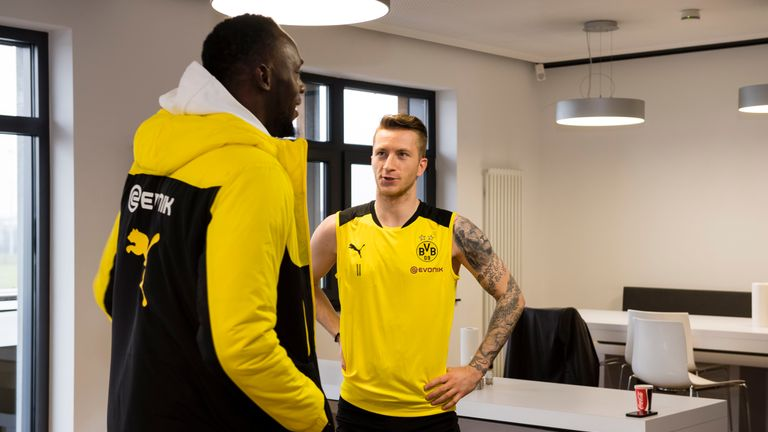 Bolt speaks with Marco Reus at the Dortmund training facility