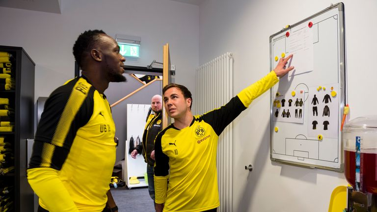 Bolt talks tactics with World Cup winner Mario Gotze