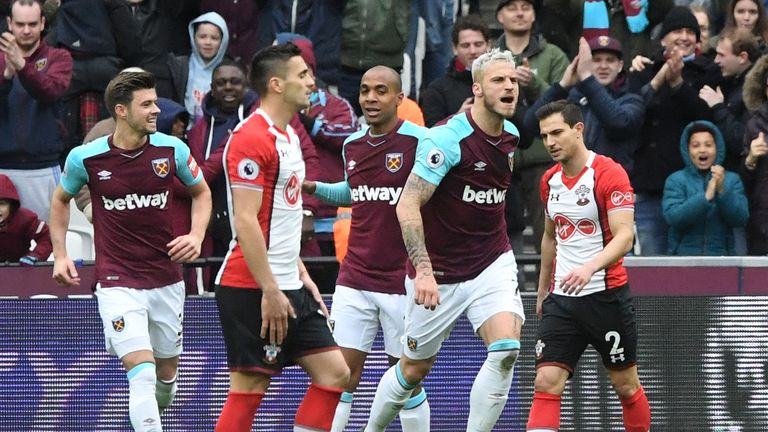 West Ham United's Marko Arnautovic (right) celebrates scoring his side's second goal of the game during the Premier League match at the London Stadium