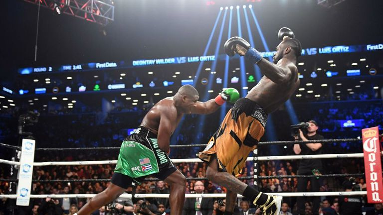 Heavyweight champion Deontay Wilder (R) of the US fights contender Luis Ortiz of Cuba during their WBC heavyweight title fight in New York on March 3, 2018. / AFP PHOTO / Timothy A. CLARY        (Photo credit should read TIMOTHY A. CLARY/AFP/Getty Images)