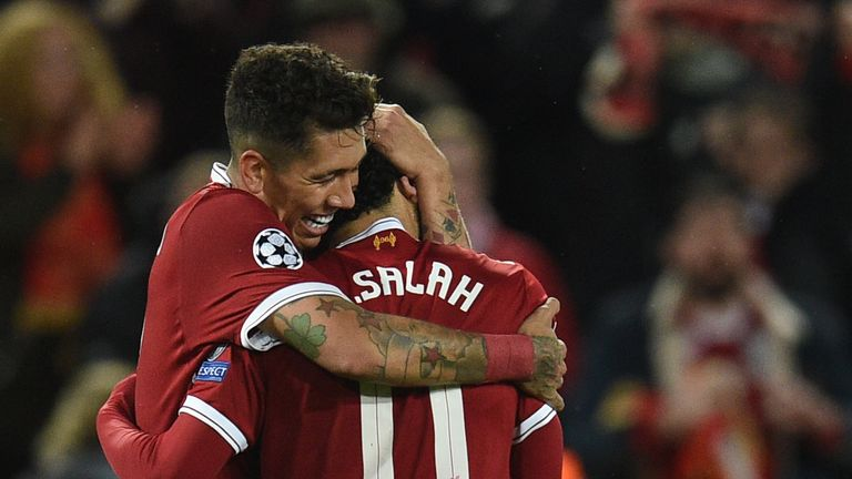 Roberto Firmino hugs Mo Salah after scoring Liverpool's fourth goal