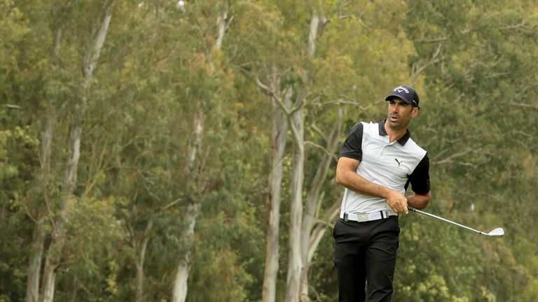 Alvaro Quiros snatched the lead back with a birdie at the last