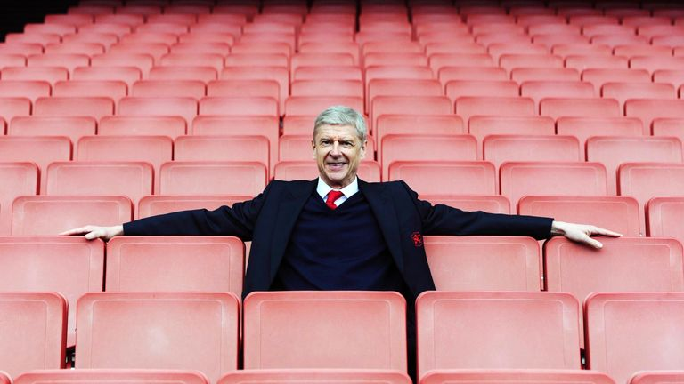 Arsene Wenger poses for a photograph after the Barclays Premier League match between Arsenal and Watford at the Emirates Stadium on April 2, 2016