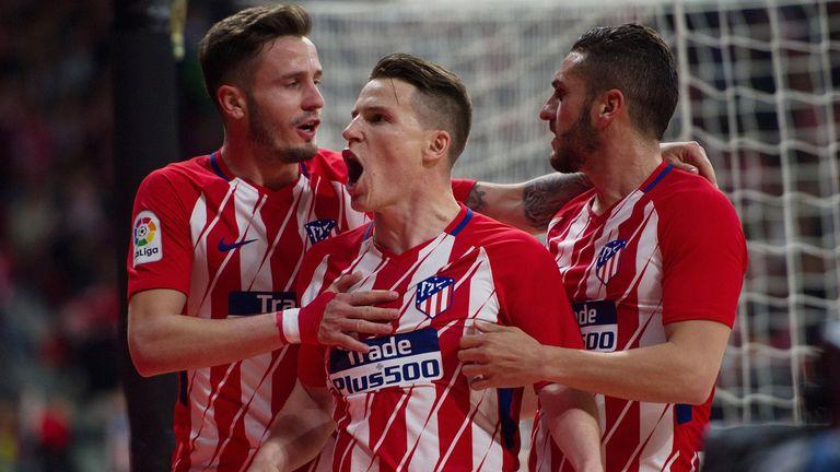Kevin Gameiro celebrates his strike for Atletico Madrid against Deportivo