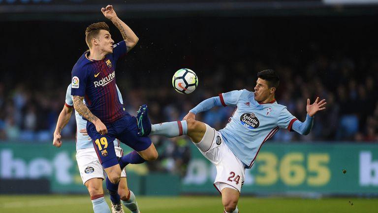 Facundo Roncaglia of Celta de Vigo competes fo the ball with Lucas Digne of Barcelona during the La Liga match between Celta de Vigo and Barcelona at Municipal Balaidos on April 17, 2018 in Vigo, Spain