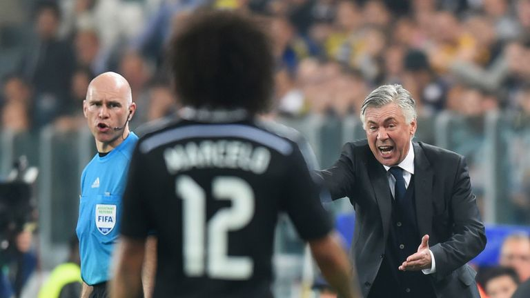 Carlo Ancelotti gives instructions to Real Madrid's Marcelo during the UEFA Champions League semi-final, first leg between Juventus and Real Madrid in Turin on May 5, 2015
