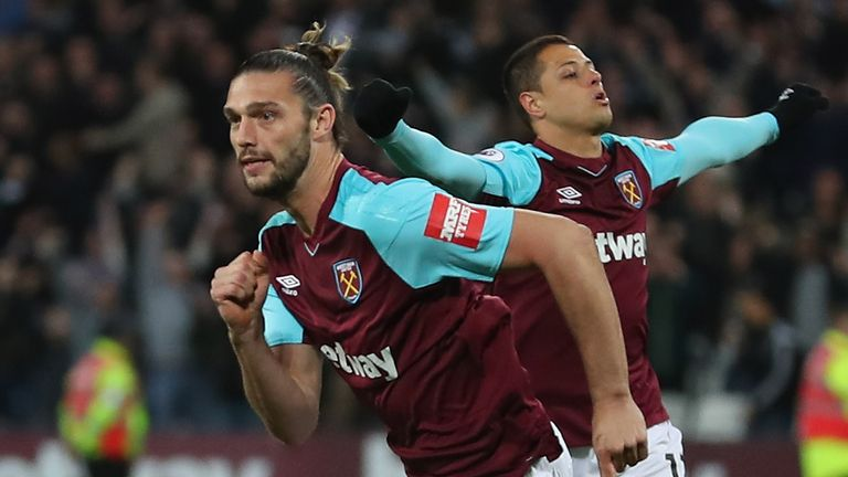 Andy Carroll celebrates after scoring West Ham's equaliser against Stoke in the Premier League.