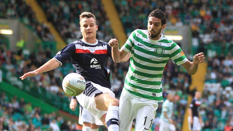 Former Celtic striker Lassad Nouioui was taken to hospital after collapsing in training
