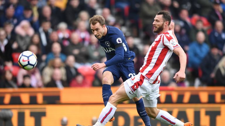 Christian Eriksen takes a shot on goal under pressure from Erik Pieters