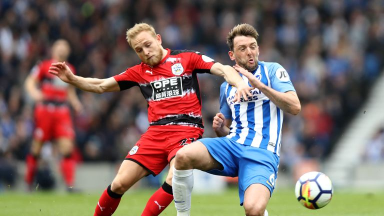 Dale Stephens is challenged by Alex Pritchard  at the Amex Stadium