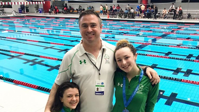 Ellen soaks up the attention with Nicole Turner (left) and coach Dave Malone