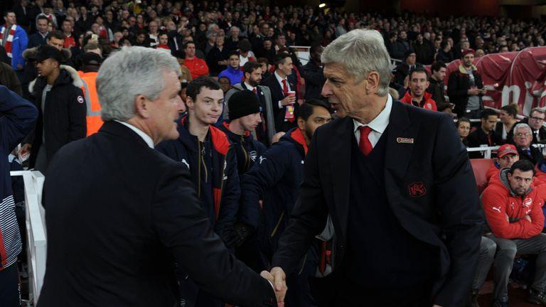 Mark Hughes and Arsene Wenger shake hands in 2016