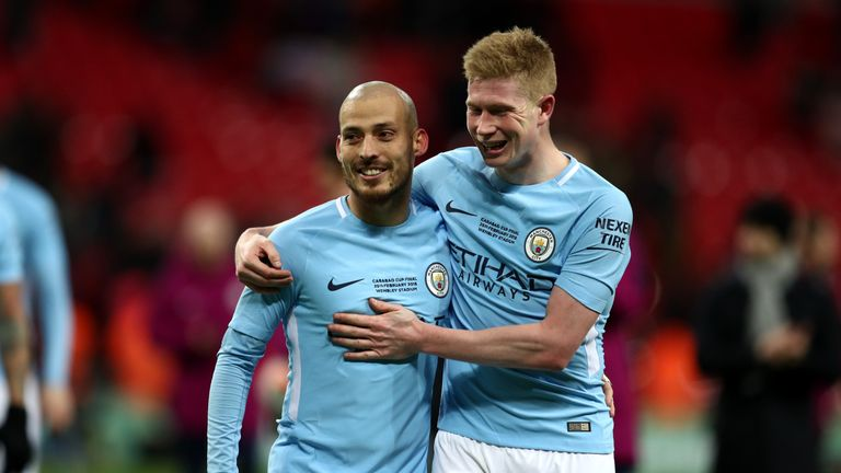 David Silva and Kevin De Bruyne celebrate Manchester City's Carabao Cup final win over Arsenal