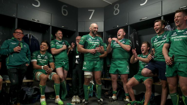 John Muldoon celebrates with teammates in the dressing room after his final game