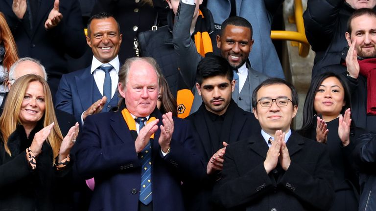 Football agent Jorge Mendes, Steve Morgan, and Jeff Shi celebrate Wolves' promotion to the Premier League