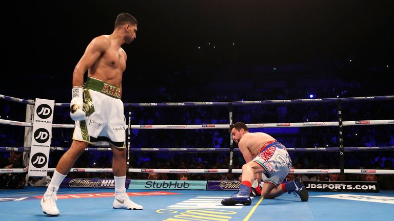Khan dropped Lo Greco with a powerful right hand