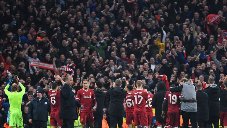 Liverpool celebrate with the fans after their Champions League win at Man City