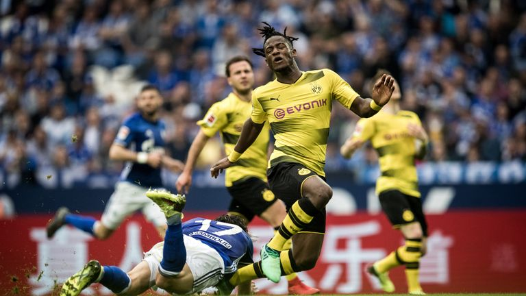 Michy Batshuayi was on the end of a heavy challenge from Schalke's Benjamin Stambouli