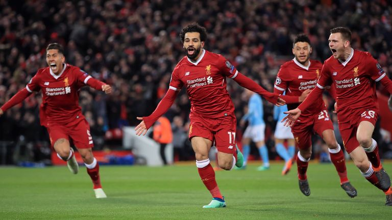 Liverpool's Mohamed Salah (centre) celebrates scoring his side's first goal of the game during the UEFA Champions League quarter final, first leg match v Manchester City at Anfield, Liverpool.