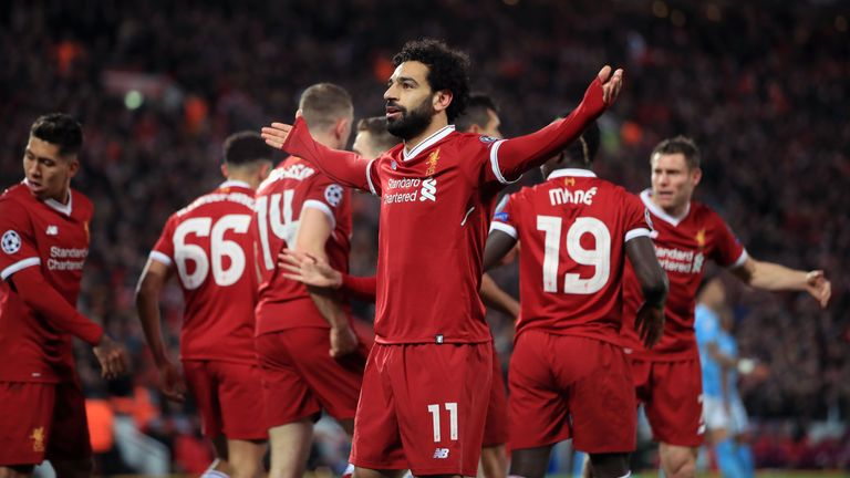 Liverpool's Mohamed Salah (centre) celebrates scoring his side's first goal of the game during the UEFA Champions League quarter-final, first leg match at Anfield