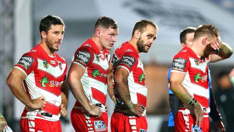 Dejected Dragons players  during the round seven NRL match against the Warriors