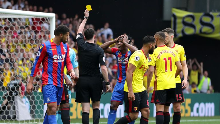 Zaha reacts as he is shown a yellow card against Watford
