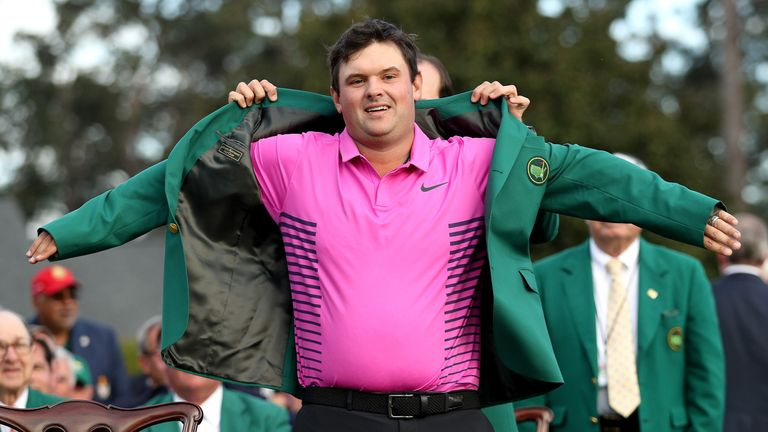 Reed is presented with his green jacket by Sergio Garcia