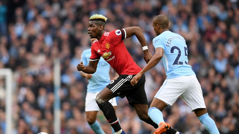 Paul Pogba surges forward during the Premier League match between Manchester City and Manchester United at the Etihad Stadium