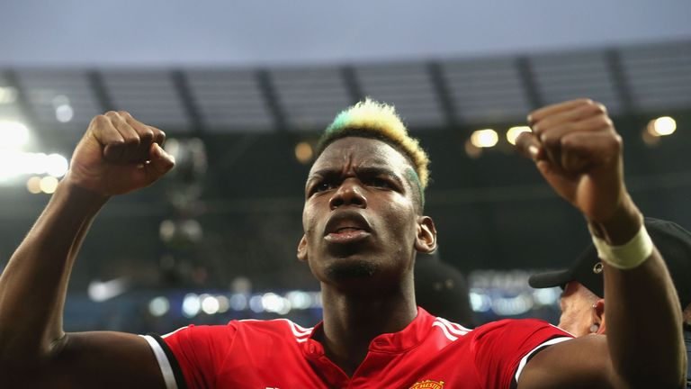 Paul Pogba celebrates after Manchester United beat Manchester City