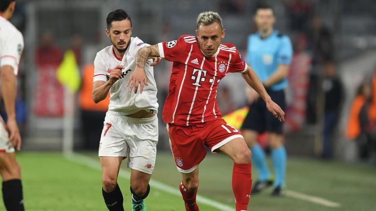Rafinha battles with Pablo Sarabia during Bayern Munich's 0-0 draw with Sevilla