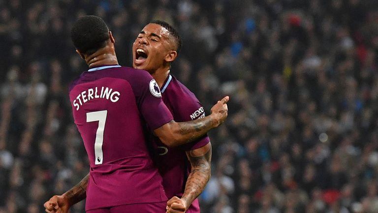 Raheem Sterling celebrates with teammate Gabriel Jesus after scoring their third goal during the Premier League match between Tottenham Hotspur and Manchester City at Wembley Stadium