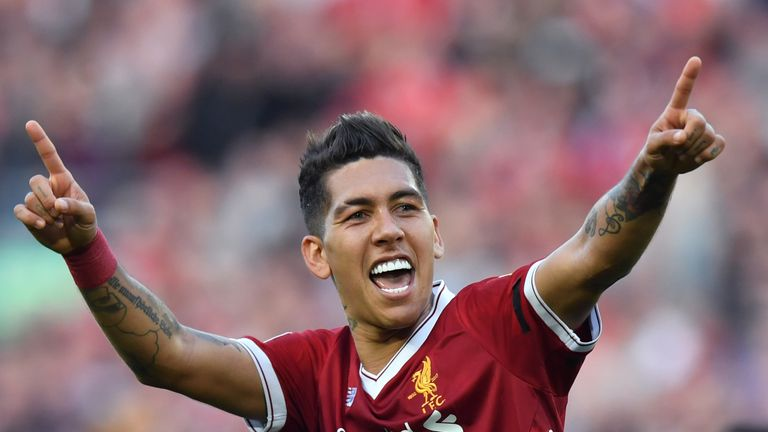 Liverpool's Roberto Firmino celebrates scoring his side's third goal of the game during the Premier League match against Bournemouth at Anfield