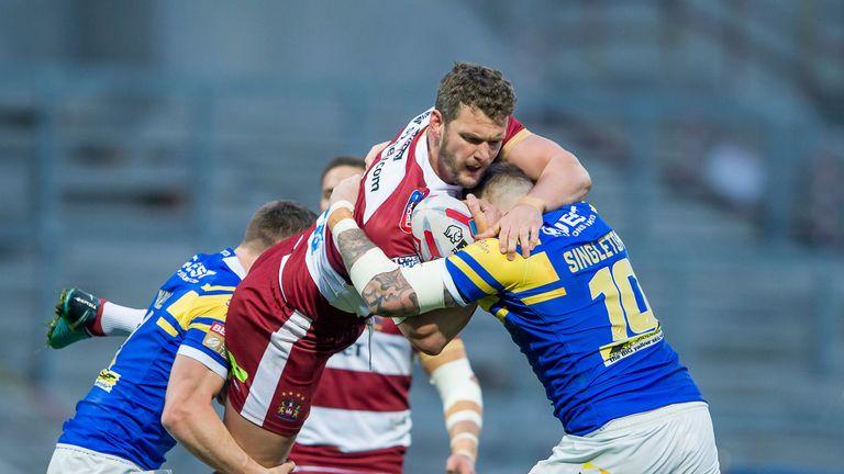 Wigan's Sean O'Loughlin is tackled by Stevie Ward and Brad Singleton