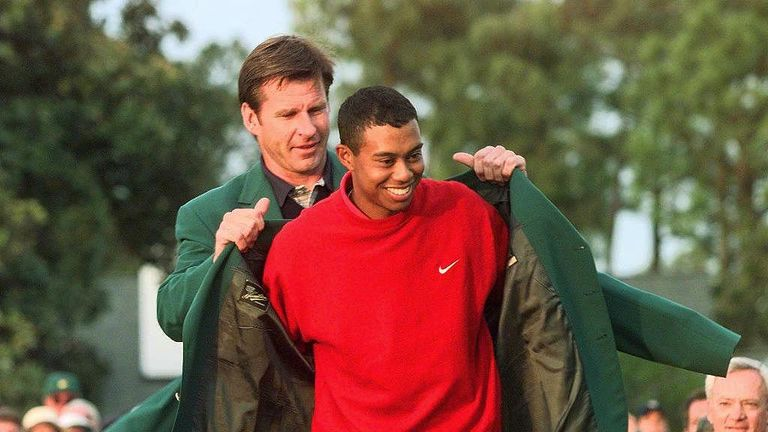 Woods dons the green jacket for the first time after his Masters victory in 1997