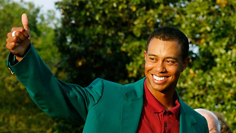 Tiger gives a thumbs up to his fans after retaining the Masters title in 2002