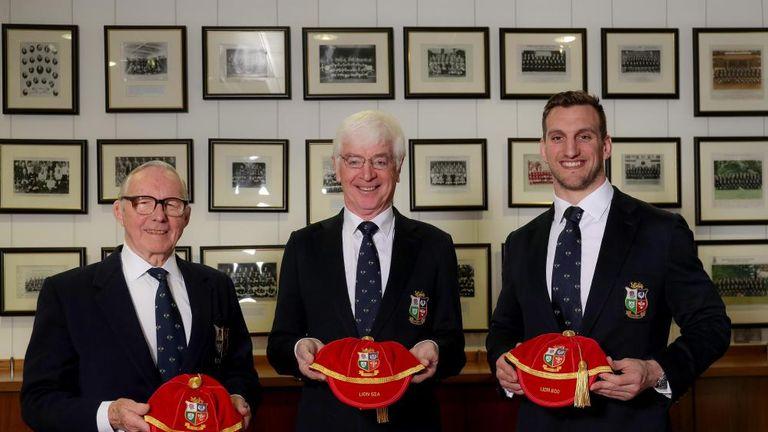 Tom Grace (centre) has presented caps to Ronnie Dawson (left) and Sam Warburton