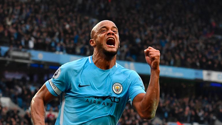 Vincent Kompany celebrates scoring the opening goal of the Manchester derby at the Etihad Stadium