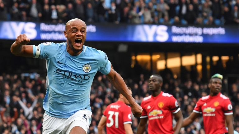 Vincent Kompany celebrates scoring the opening goal of the game