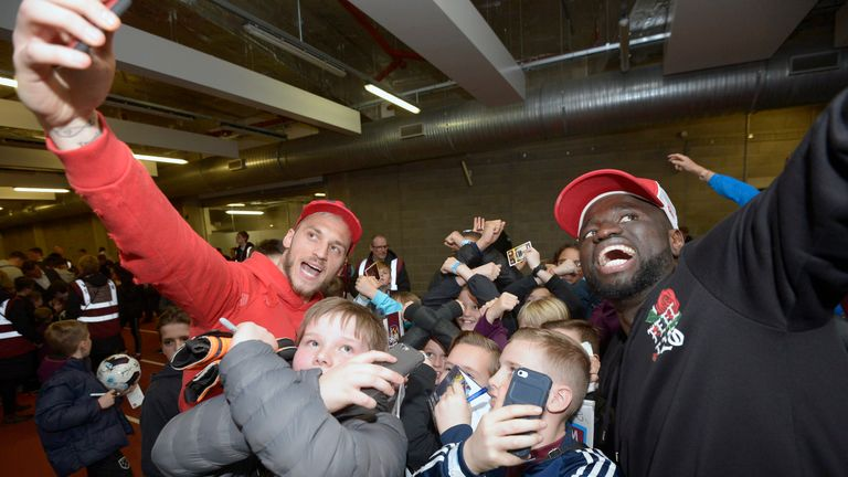 Marko Arnautovic (L) and Cheikhou Kouyate (R) pose for pictures with West Ham's junior supporters (Courtesy of  West Ham United Football Club)