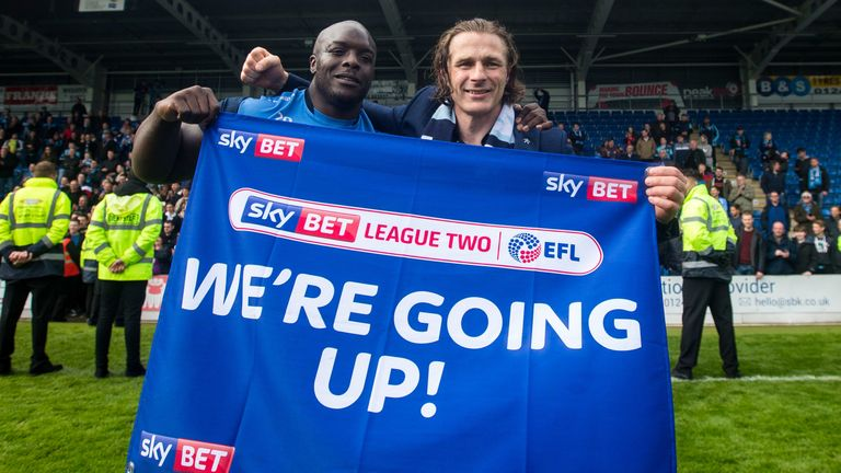 Wycombe Wanderers manger Gareth Ainsworth and striker Adebayo Akinfenwa celebrate promotion to League One (credit: Sky Bet/JMP)