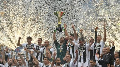 Gianluigi Buffon lifts the Serie A trophy following his final Juventus appearance
