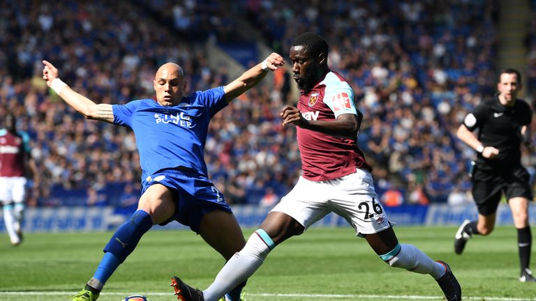 Arthur Masuaku is challenged by Yohan Benalouane