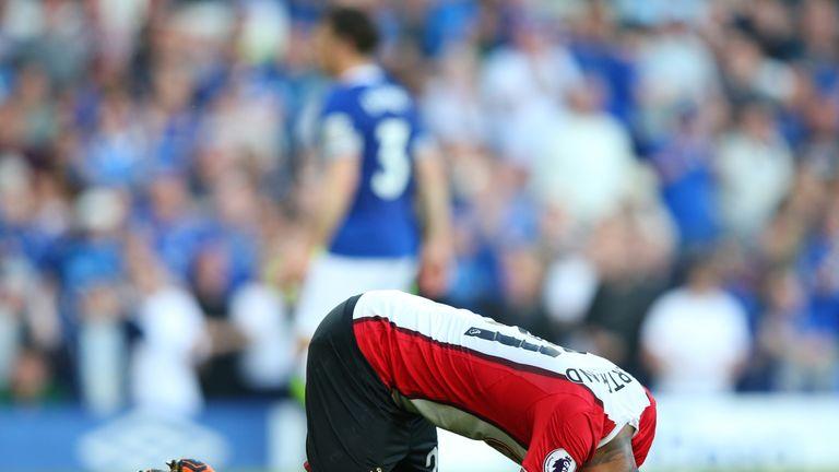 Ryan Bertrand falls to the turf following Tom Davies' injury-time equaliser
